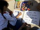 Child making signs